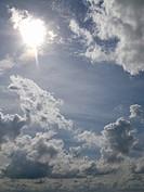 Clouds and sun in blue sky
