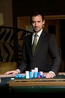 Young man gambling, portrait