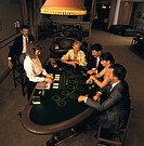 Overhead view of people playing blackjack in casino