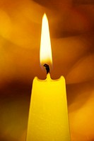 Burning yellow candle