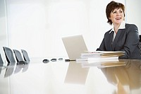 Businesswoman Using Laptop Computer in Conference Room