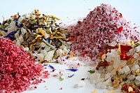Colourful sea salts, with several spices and herbs like hibiscus, rose petals, chili and paprika