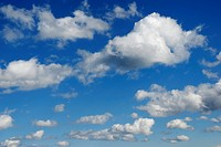 Fast flying cumulus clouds on brilliant bue sky