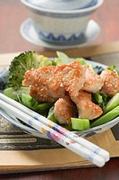 Chicken fillet with sesame seeds on broccoli Asia