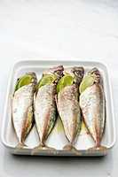 Marinated sardines with lime wedges