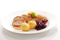 Roasted chicken breast served with cranberries, dumplings, red cabbage and gravy