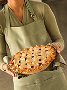 Woman Holding Cherry Pie