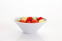 Candy eggs in a porcelain bowl