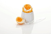 Boiled breakfast easter egg in an egg cup with egg spoon