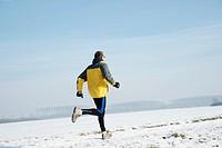 Man jogging in a wintery landscape
