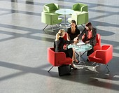 Three businesswomen having a meeting in office building