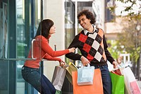Woman trying to pull boyfriend back into store