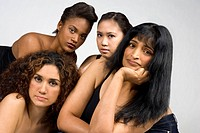 Multicultural group of four woman looking straight to the camera