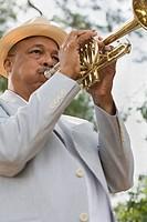 Senior African man playing trumpet