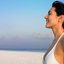 Woman with eyes closed at beach