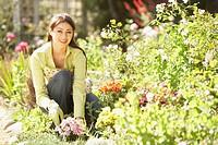 Portrait of Hispanic woman gardening