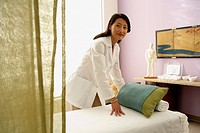Asian female doctor preparing treatment table