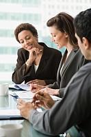 Multi_ethnic businesspeople having meeting