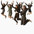 Multi_ethnic businesspeople jumping