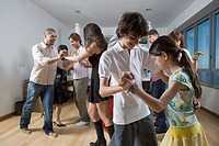 Multi_ethnic friends dancing at party