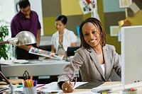 African businesswoman working at desk