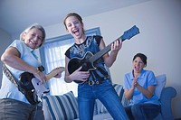 Multi_generational family playing guitars