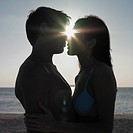 Silhouette of couple hugging at beach