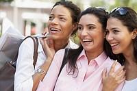 Multi_ethnic women laughing
