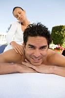 Portrait of man having massage