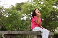 Young girl eating ice cream.