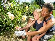 Woman and girl gardening