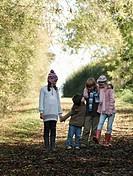 Children chatting on country lane