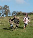 Children running in countryside