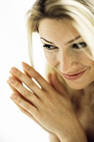 Woman clasping hands, portrait