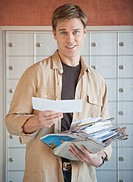 Man sorting stack of mail