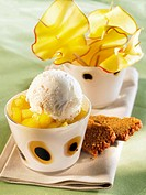 Stewed mangoes with almond ice cream