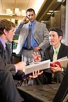 Portrait of multi_ethnic businessmen working in modern lobby