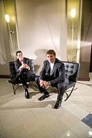 Portrait of multi_ethnic businessmen sitting in modern lobby
