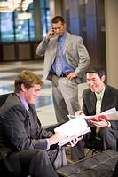 Portrait of multi_ethnic businessmen in modern lobby