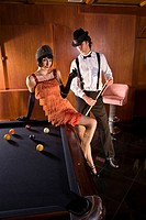 Portrait of 1920s socialite couple at billiards table 1920s bar