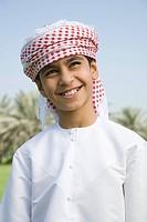 Portrait of a boy wearing a headdress