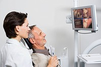 Dentist and patient looking at monitor