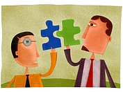 Two businessmen holding puzzle pieces that fit together