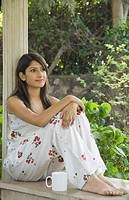 Woman sitting in a gazebo and day dreaming, New Delhi, India