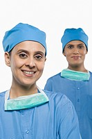 Portrait of two female surgeons smiling