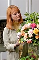 Woman arranging roses