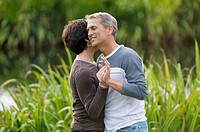 Couple dancing outdoors in grass