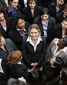 Group of business women looking at woman standing in middle elevated view