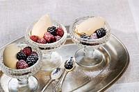 Herb liqueur ice cream with fresh berries Gelato al braulio, Piedmont