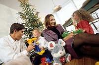 christmas, family, gift_giving, cheerfully, series, people, parents, pair, children, two, siblings, floor, sitting, christmas_tree, christmas eve, gif...